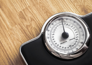 weight scale on wooden floor